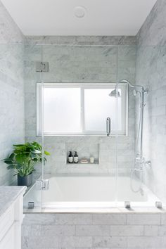 Marble bathroom with a hint of greenery= Our favorite mix!
