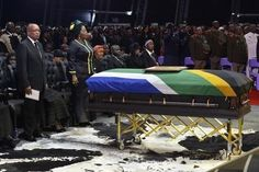 South African President Jacob Zuma (L) attends the funeral ceremony of former South African President Nelson Mandela in Qunu December 15, 20...