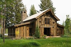 This striking old timber frame rustic-modern barn is built from the reclaimed wood of older structures by RMT Architecture near the Swan Mountain Range in Montana. Country Barns, Old Barns, Converted Barn, Rustic Exterior, Exterior Design, Barn Living, Barns Sheds, Dream Barn, Timber House