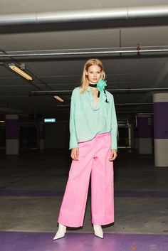 nude, fluo cotton shirt, fluo over-pants, floral broach