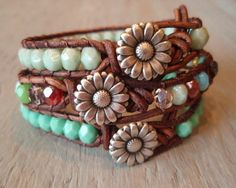 "Boho leather wrap bracelet, ""Country Girl"", Shabby chic, rustic mint green, silver daisy flower, celadon, bohemian chic. $39.00, via Etsy."