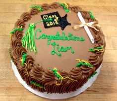 A small celebration with a simple buttercream grad cap draw on the cake
