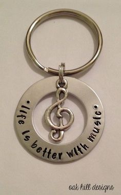 Metal Jewelry stamped music lover keychain with charm-life is by OakHillDesigns Music Jewelry, Metal Jewelry, Jewelry Crafts, Jewelry Art, Handmade Jewelry, Penny Jewelry, Yoga Jewelry, Jewelry Ideas, Silver Jewelry