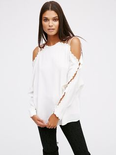 Another Love Cold Shoulder Top | Gorgeous top featuring pretty open arm details and sweet scalloped crochet accents on the shoulders and sleeves. Easy, flowy fabrication and silhouette. Front lined.