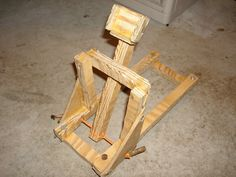 There are different variations of catapults, but watch this video for how to build my version of a wooden torsion catapult.