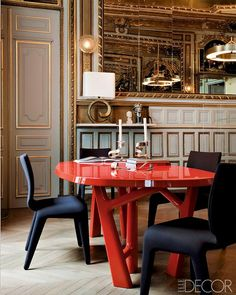 lacquered-oak table by christophe delcourt   chairs by roche bobois