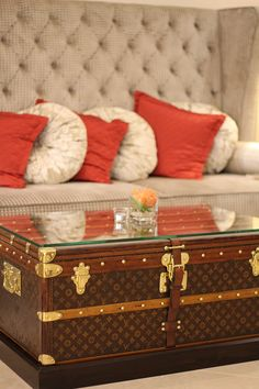 ~Louis Vuitton or trunk suitcase coffee table with glass and bumpers added on under glass for stability. Love this!