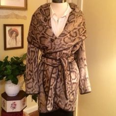 DVF Leopard Print Wrap Coat This is a beautifully thick and warm coat by DVF. Size Medium. It wraps generously and could fit a size large too, in my opinion. Measurements taken on request. Matching fabric belt. New with tags!! Gorgeous!! Diane von Furstenberg Jackets & Coats Blazers