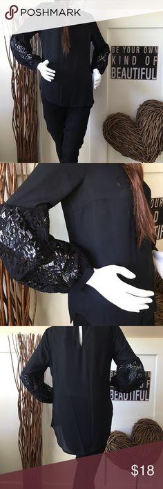 Apt 9 Black tunic with lace arms Pretty black tunic has pretty sleeves with bottom of arm being made of lace. This tunic is longer in the back. Apt. 9 Tops Tunics