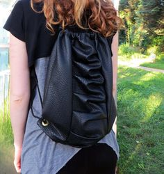 Unique mini backpack made of a faux leather. It is elegant and also sporty.  It is something special. Backpack is unisex. This trendy bag is