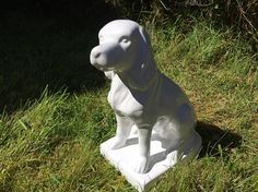 large white porcelain spaniel dog statue / white ceramic dog