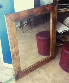 Mirror with pallets