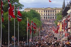 The Royal Palace-Oslo  The main street in Oslo (Karl Johans gate) at 17th of May celebrating the norwegian national day. The children from Oslo's schools marching up the street and passing the castle cheering to the royal family