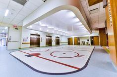 Photo Tour: Shriners Hospitals for Children—Canada   Healthcare Design --- No, that's not a hockey rink for the Montreal Canadians. Rather, it's the ambulatory clinic inside the new hospital, which comes complete with a scoreboard to direct patients to their exam rooms and red hockey goal lights hanging from the ceiling. Photo: Benoit Desjardins