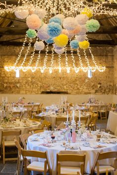 Strung up firelight canopy | Pom pom decor | A disney princess wedding | Barn Reception | pastel colour scheme| Images by Source Images | http://www.rockmywedding.co.uk/sam-ben/