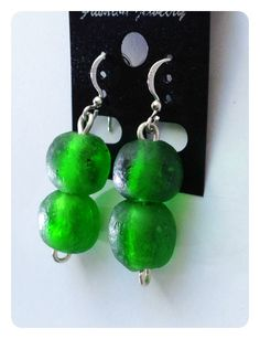 These Stunning Sterling silver drop earrings are made with emerald coloured recycled glass beads from Ghana.