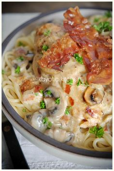 Country Club Chicken  1 pound spaghetti  4 chicken breasts  1 large onion  7 oz mushrooms  1 can concentrated cream of mushroom soup  (1 Unox or 2 Campbell's)  4 or 5 slices bacon  1/4 cup dry white wine  2/3 cup sharp cheddar  1 apple  butter or oil  salt & pepper