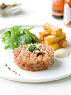 Belgian cuisine - Filet Americain Preparez or Preparez in short. Very central in Belgian culture. Most butchers have their own recipe for the vinaigrette with which the grinned beef is prepared. You can buy a pistolet preparez (on bread) at the butcher