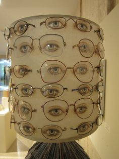 Santa Fe New Mexico  Art display at the Capitol Building  Lamp shade with eyes painted on the shade and then eyeglass frames.