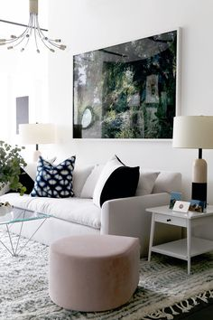 white living room with pops of color and oversized art via @citysage
