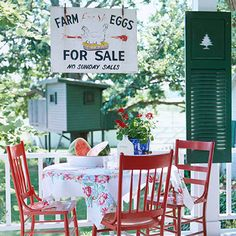 Home Interior Decoration Going Country ~ On the front porch, cherry-red chairs seated around a table provide a nostalgic spot to enjoy morning coffee or a simple meal. A repainted shutter finds a new home on a porch beam and becomes easy artwork. English Cottage, Eggs For Sale, Outdoor Dining, Outdoor Decor, Outdoor Seating, Outdoor Spaces, Bastille Day, Painted Chairs, Painted Furniture