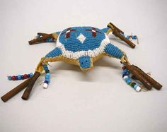 Lot: 1048A: Plains Indian Beaded Turtle Fetish Bag 4'', Lot Number: 1048A, Starting Bid: $50, Auctioneer: Desert West, Auction: Desert West Native American Auction May 31, Date: May 31st, 2009 MDT