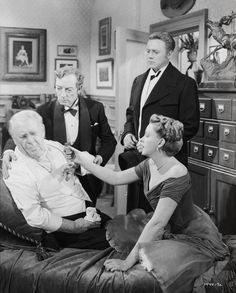 Full shot of C.Z. Sakall as Otto Oberkugen, seated on couch, surrounded by Buster Keaton as Hickey, Van Johnson as Andrew Delby and Judy Garland as Veronica Fisher. In The Good Old Summertime.