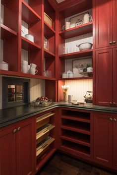 Red kitchen pantry boasts barn red cabinets adorned with satin nickel knobs and finished with shelves fixed beneath a black stone countertop mounted against a white beadboard backsplash that frames a small black framed window. Black Backsplash, Beadboard Backsplash, Herringbone Backsplash, Backsplash Wallpaper, Hexagon Backsplash, Travertine Backsplash, Backsplash Ideas, Red Kitchen Cabinets, Black Cabinets