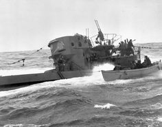 Boarding party from the corvette H.M.C.S. CHILLIWACK alongside the German submarine U-744 at sea, 6 March 1944.