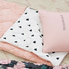 Reminiscent of Parisian petticoat designs, this sleeping bag is fashionable and oh-so-cozy. Ruched pintucks in soft pink and a heart-patterned interior add dreamy French design to slumber party fun!