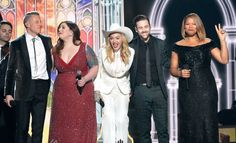 Macklemore, Mary Lambert, Madonna, Ryan Lewis, and Queen Latifah onstage on the 56th Annual GRAMMY Awards on Jan. 26 in Los Angeles