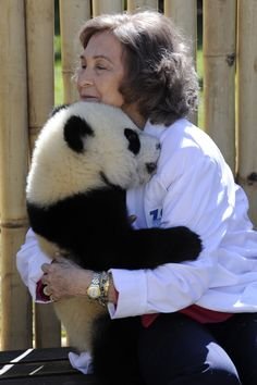 Spain's Queen Sofia hugs a 7-month-old panda cub during her visit to Madrid's Zoo on March 29, 2011 in Madrid.
