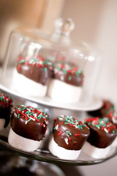 Cute and simple.  Marshmallows dipped in chocolate. Maybe I would use mini marshmallows and call them reindeer poop :)