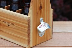 Handmade wooden six pack carrier with bottle opener.  Give this with six bottles of unique soda or beer.