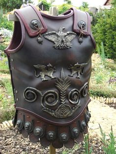 Muscle cuirass translated from bronze to leather.  Again a modern version based on Roman styles, but quite realistic.  Muscle cuirasses were generally reserved for senior officers; certainly a leather version would been possible in 5th Century Britain.