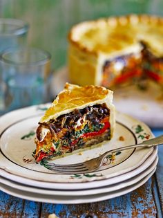 Picnic pie Ingredients  3cloves ofgarlic 3sprigs offresh rosemary 2largered onions 2aubergines 2courgettes 1mediumbutternut squash olive oil 3largered peppers 1tablespoonbalsamic vinegar ½teaspoongolden caster sugar 600gbaby spinach 200gricotta cheese 2lemons 60gParmesan cheese unsalted butter, for greasing plain flour, for dusting 640gshortcrust pastry 1bunch offresh basil 100gsoft goat's cheese 1largefree-range egg