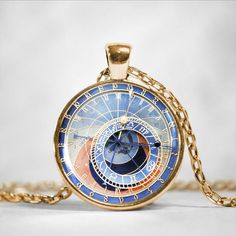 This is a photo of an astrological clock with a custom hardened resin insert to show the highest quality color vibrance. Gold Plated Necklace, Gold Pendant Necklace, Clock Necklace, Necklace Chain, Necklaces, Prague Astronomical Clock, Wedding Gifts For Groomsmen, Beautiful Watches, Round Pendant
