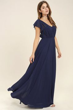 It's no wonder why we're head over heels for the Falling For You Navy Blue Maxi Dress! Woven poly forms wide, sheer straps (with fluttering accents) that overlay a strapless sweetheart bodice with princess seams, no-slip strips, and elastic at back. Full skirt cascades from a fitted waist to a floor length. Hidden back zipper/hook clasp.