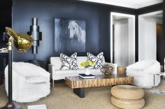 Dark walls- white upholstery- rustic coffee table