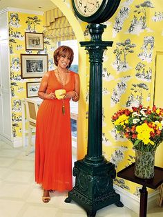 "Hollywood at Home: Inside Stars' Favorite Rooms | GAYLE'S KITCHEN | This is where the (culinary) magic happens! King chose to create a year-round sunny spot in her kitchen drenched in her favorite hue. ""It's impossible to be surrounded by yellow and not feel good,"" Oprah's BFF says of her bright space, which features an oversized antique clock. ""It makes me smile every time I walk into the room."""