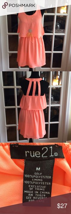 Light Salmon Dress sz M Cute feels like chiffon light weight and lined. Has elastic waist and back has elastic along upper back. Cute detail on back . Shown with dream catcher necklace also for sale in my closet. Rue 21 Dresses