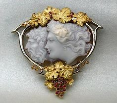 "Cameo Brooch ""Pan and Diana"", 22Kt Gold, cabochon rubies as grapes"
