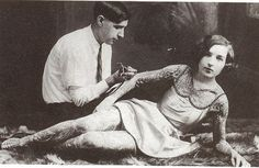 vintage everyday: A woman being tattooed, early 1900s