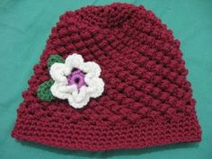 Raspberry Stitch Beanie - Crochet Tutorial. Just finished this hat for my daughter (almost 16), and it turned out great. The differences I did were 16 rows instead of 17, and for the brim I did four rows of single stitch.