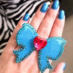 This cute ring was made by Audrey Tucker from San Francisco, by coating vinyl with Little Windows Brilliant Resin, adding crystals around the edge, and a heart jewel to the center.  Love it!