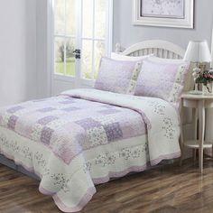 @Overstock.com - Love of Lilac Quilt Set - Spring is in full bloom in this quilt set, fashioned from a patchwork of lavender purple and white with a hint of green floral prints. The quilt has scalloped hem with a detailed embroidered edge and reverses to a mini lavender floral print.  http://www.overstock.com/Bedding-Bath/Love-of-Lilac-Quilt-Set/6422148/product.html?CID=214117 $69.99
