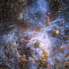 view shows part of the very active star-forming region around the Tarantula Nebula in the Large Magellanic Cloud, a small neighbor of the Milky Way. At the exact center lies the brilliant but isolated star VFTS 682 and to its lower right the very rich star cluster R 136.