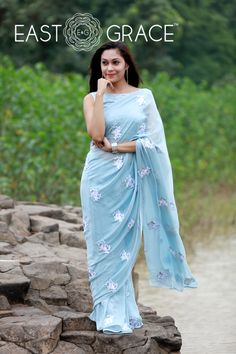 Featuring a soft powder blue pure silk chiffon saree with light white ribbonwork floral motifs embroidered all over it. PRICE: INR 15,499.00; USD 234.83 To buy please click here: https://www.eastandgrace.com/products/powder-blue-white For help reach us at care@eastandgrace.com. With love www.eastandgrace.com