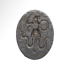 Gnostic Hematite Intaglio with Figure and Magical Inscriptions, 2nd-4th Century A.D.  Egypt -  Size: 3.6 cm L - 1 7/16 iches