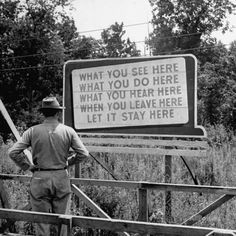 Oak Ridge, August WWII era billboard at the Oak Ridge Facility warning workers to keep silent w. regards to anything seen or heard here. (Manhattan Project aka development of the atom bomb, was undertaken here) Nagasaki, Hiroshima, Fukushima, Oak Ridge Tennessee, East Tennessee, Tennessee Waltz, Vietnam, Las Vegas, Manhattan Project